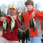 Father and son with crappies