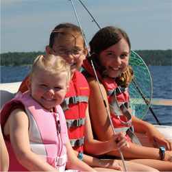 kids having fun fishing on a pontoon