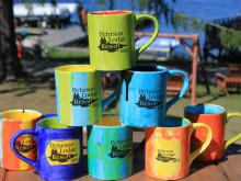 Kids painted rainbow mugs as part of the Lake Vermilion childrens program.