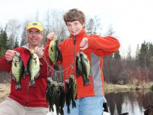 Eric Hanson and his son with their stringer of crappies from lake Vermilion.