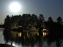 Cabin view from lake Vermilion at night