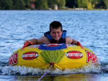 Resort guest water tubing on Lake Vermilion during his vacation.