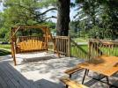 Deck area with picnic table, swinging bench and views of the lake.