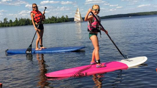 Mother and daughter paddleboarding on Lake Vermilion