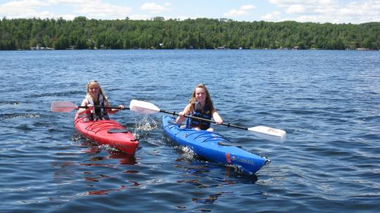 Two teens kayaking on Lake Vermilion