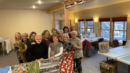 A group of quilters in the Grand Vermilion Chalet