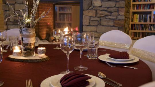 A winter table setting near the fireplace in the Main Lodge