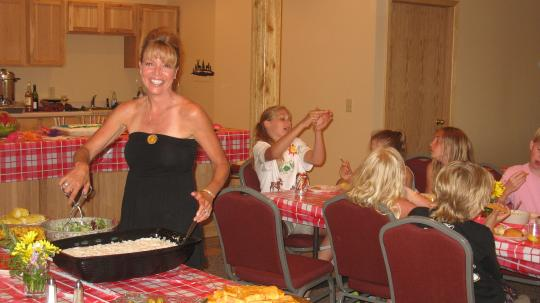 Dinner is served at a family reunion in the Grand Vermilion Chalet