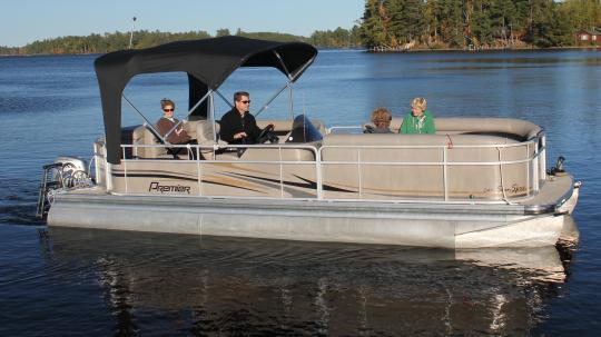 Premier Pontoon boat with family on Lake Vermilion