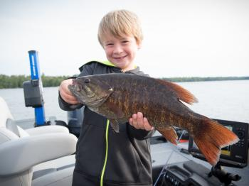 Young fisherman shows off a nice bass
