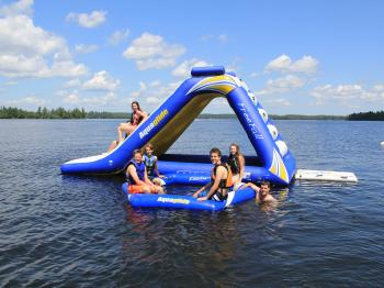 Guests enjoy the inflatable water slide