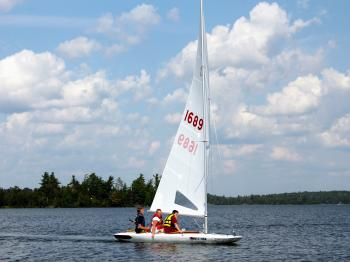 Boys go for a sail on one of Pehrson Lodge's MC-Scows.