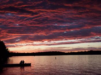 Couple on the dock enjoys a Lake Vermilion sunset