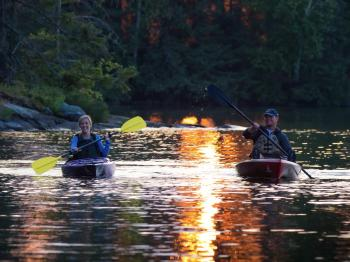 Couple kayaking at sunset