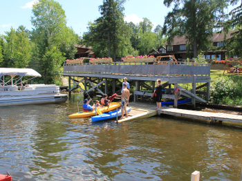 Pehrson Lodge dock staff help guests launch kayaks