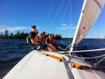 Group sailing on A scow on Lake Vermilion