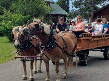 A family begins their horse-drawn wagon ride at Pehrson Lodge