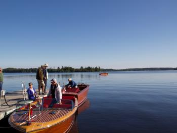 Classic wooden boats, hosted at Pehrson Lodge, prepare for the Classic and Antique boat show on Labor Day Weekend.