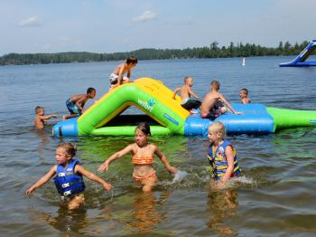 Children enjoy the beach at Pehrson Lodge