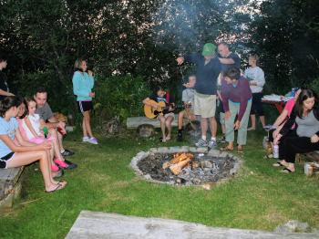 Families join together at the weekly resort s'mores night