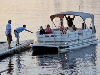 A family returns from a pontoon cruise on Lake Vermilion