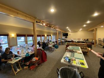 A crafting group in the Grand Vermilion Chalet