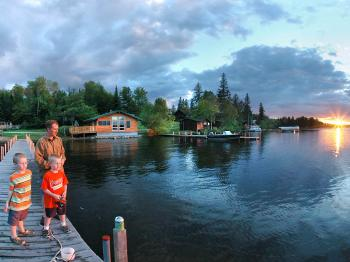 A family fishes from a dock at Pehrson Lodge