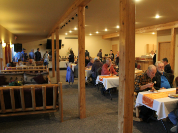 Guests enjoy a mean in the basement of the Grand Vermilion Chalet