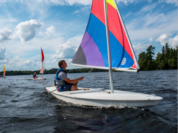 Three sunfish sailing on Lake Vermilion