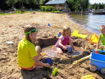 Children making a sandcastle at the Pehrson Lodge beach