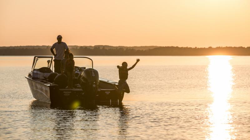 Father and son in boat on Lake Vermilion at sunset.