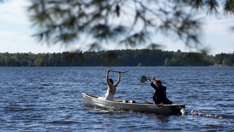 Just married couple in a canoe on Lake Vermilion
