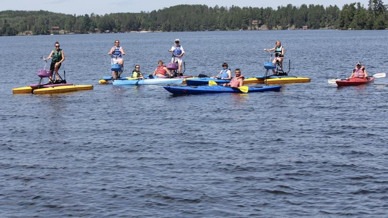 Large group of kayakers and hydro-bikers
