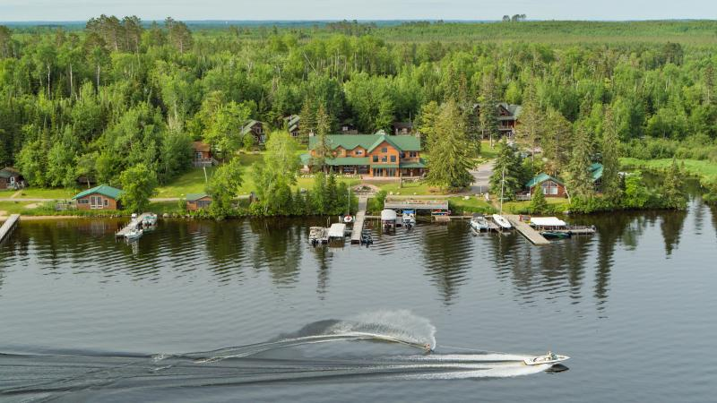 Overhead shot of Pehrson Lodge on Lake Vermilion with waterskier going by