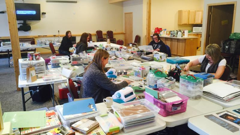 A scrapbooking group in the Grand Vermilion Chalet