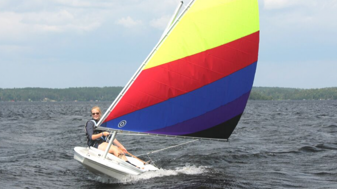 woman on sunfish sailboat